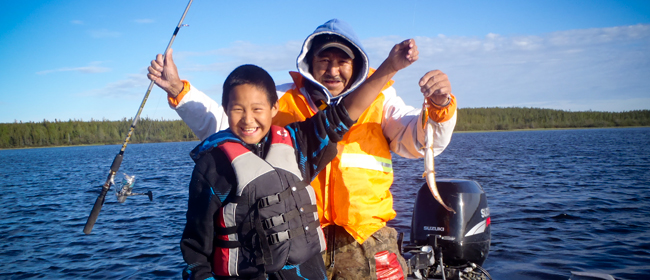 George St. Pierre and Dalten Denechezhe fishing on Wollaston Lake<br>Photo courtesy of CanNorth