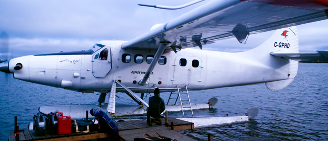 Docking at the plane for pickup at Cree Lake<br>Photo courtesy of CanNorth