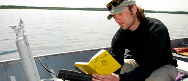 Ryan Froess of CanNorth taking limnology measurements on Black Lake<br>Photo courtesy of CanNorth